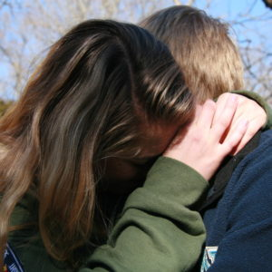 two young people hugging