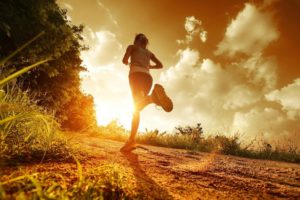 young woman jogging in morning sunlight