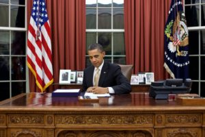 President Barack Obama signs H.R. 3630 - Middle Class Tax Relief and Job Creation Act of 2012 in the Oval Office, Feb. 22, 2012. (Official White House Photo by Pete Souza) This official White House photograph is being made available only for publication by news organizations and/or for personal use printing by the subject(s) of the photograph. The photograph may not be manipulated in any way and may not be used in commercial or political materials, advertisements, emails, products, promotions that in any way suggests approval or endorsement of the President, the First Family, or the White House.