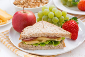 healthy school breakfast with fresh fruits and vegetables, close-up, horizontal